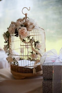 Roses on birdcage, would be easy to make with rose swag from Micheals.