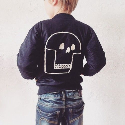Look at this little dude's attitude. He's in Australia wearing a bomber jacket with a skull I drew for @rock_your_baby A/W15 ✊