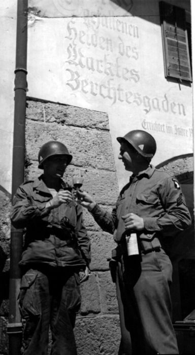 "Soldiers from the 101st Airborne toast with the Führer's wine to the capture of ""The Eagle's Nest"" at Berchtesgaden"