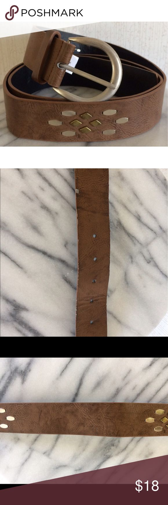 Studded Brown Faux Leather Belt Good condition. Some wear near the holes. Some wear on the back. Super cute faux leather belt. Nice texture to look like leather grain. Gold and silver stud patterns. Silver buckle. Size 16. All offers welcome Accessories Belts