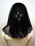 This is a veil that is embroidered with silver luster yarn in the black background. It is a feminine design with gentle flower patterns. It looks a little darker than you see in the photos.