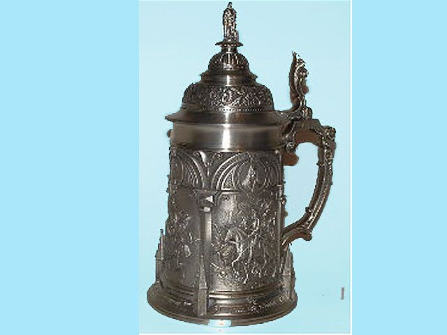 10.  Albrecht Durer pewter stein. A German Renaissance artist (1472-1528)   His extraordinary engraving of Knight, Death, and the Devil is featured in fine bas-relief on the facing panel of this pewter stein. The other panels are adorned with his Knight and Foot soldier, Dancing Farmer Couple and Market Place. The base is flanked by upright towers of Nuernberg patrician houses and on top is a pewter figurine of Albrecht Durer himself. 8 1/2 inches tall, 1/2 liter.