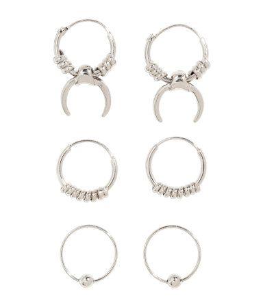 Silver-colored. Mini hoop earrings in metal. Diameter approx. 1/2 in.