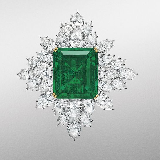 Harry Winston gold and pear-cut diamond brooch, with a central rectangular-cut emerald, weighing 42.88 carats. Circa 1971. Estimate: $700,00...