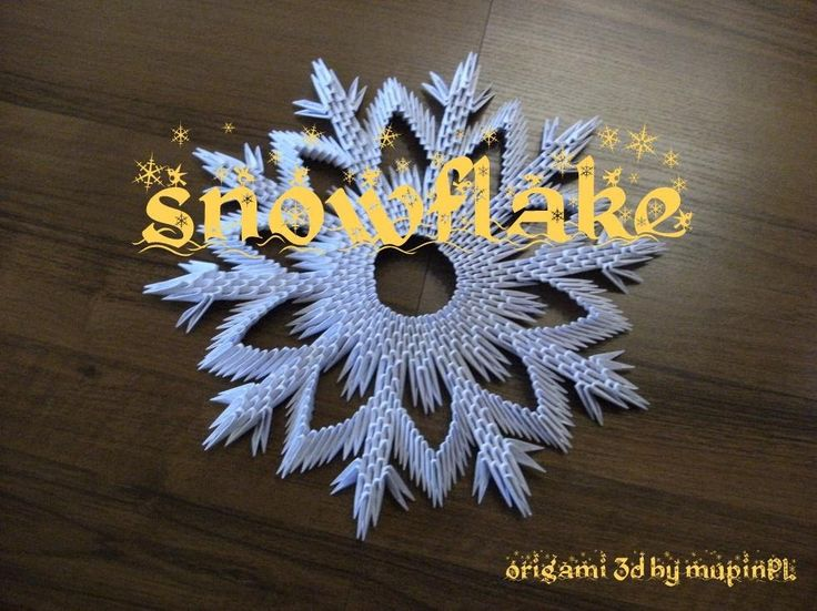 video showing how to make a paper snowflake