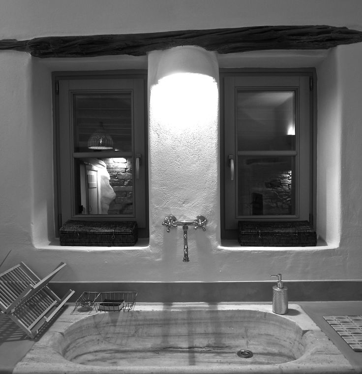 Aged marble sink and wooden lintel.