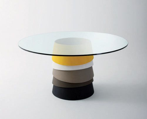 Layer by Luca Nichetto (above) features stacked wooden rings to form the base of this glass-topped table. They appear to be unsteady and may topple over at any moment but not so. The rings come in a variety of colors for you to customize.