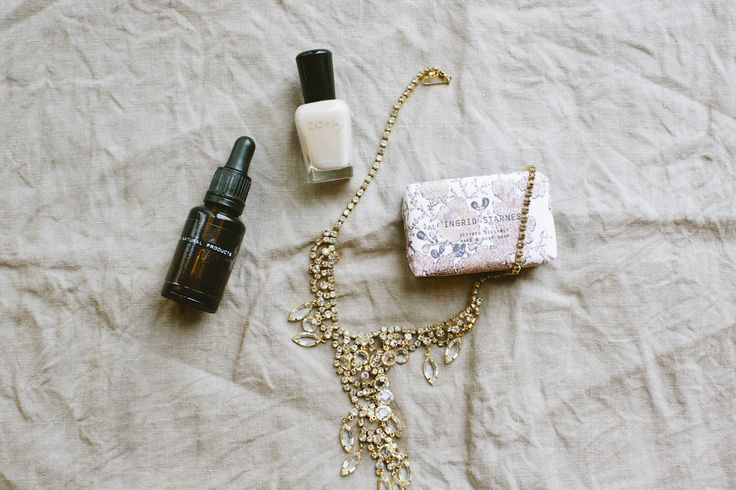 THE DETAILS: jewels by Love and Object, scented soap bar by Ingrid Starnes, nail polish by Zoya, and face oil by Dr. Jackson.