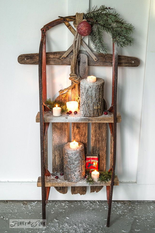 Snow sleigh shelf with Christmas log candles on FunkyJunkInteriors.net