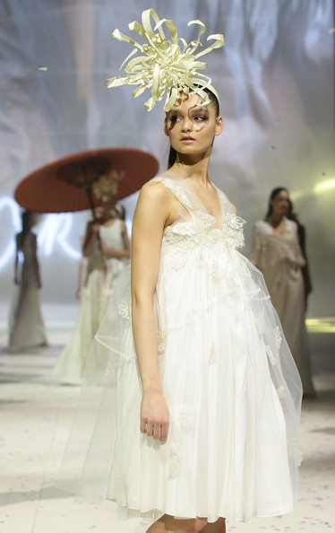 A model showcases designs by Akira on the catwalk as part of Mercedes Benz Fashion Festival Sydney 2012 at Sydney Town Hall on August 21, 2012 in Sydney, Australia.
