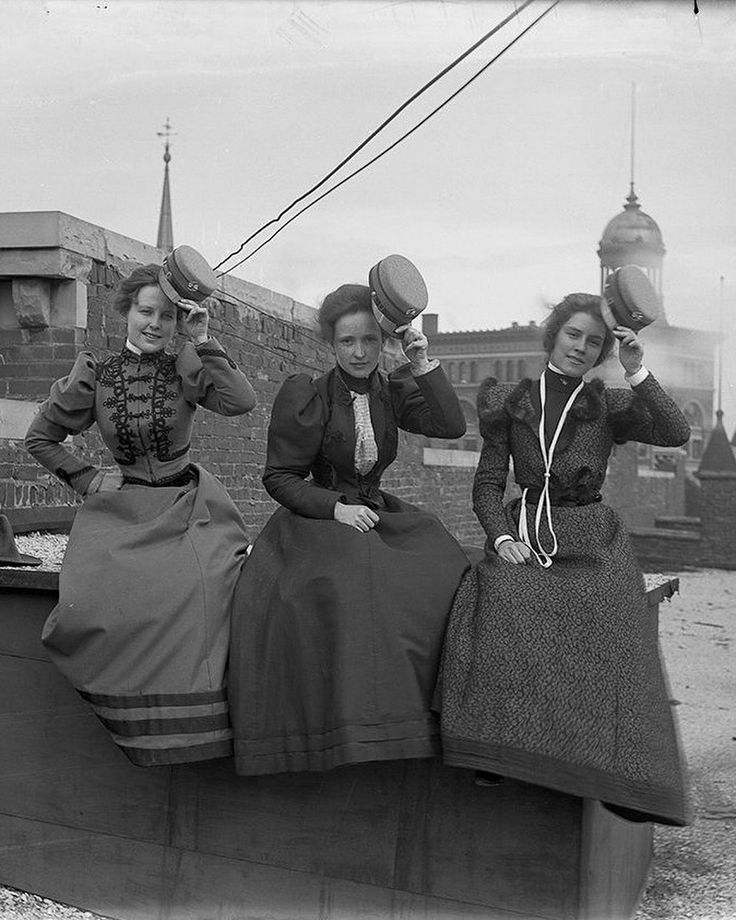"""Department store lunch break, ca. 1898-1900. Workers get a breath of fresh air on the rooftop"""