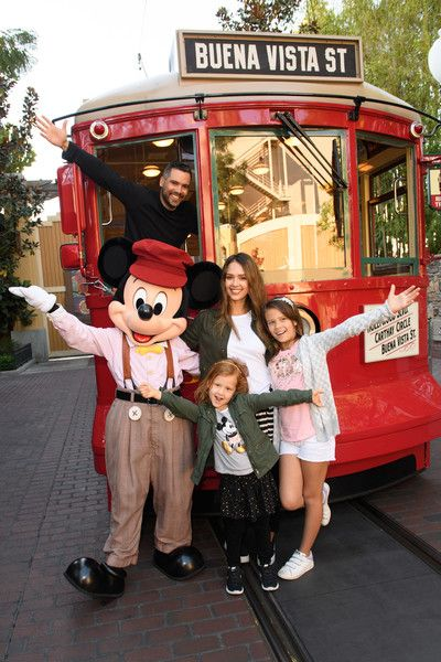 Jessica Alba Photos Photos - In this handout photo provided by Disney Parks, Actress Jessica Alba, husband Cash Warren and daughters Honor and Haven take a ride with Mickey Mouse on the Red Car Trolley at Disney California Adventure Park on March 31, 2017 in Anaheim, California. - Jessica Alba And Family At Disney California Adventure