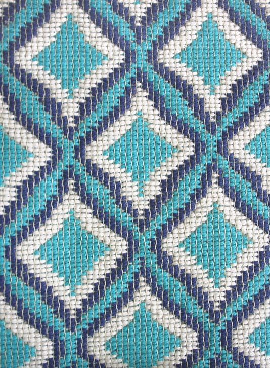 Luv Fabric A hard wearing woven fabric with a diamond shaped pattern repeat in turquoise, blue and white.