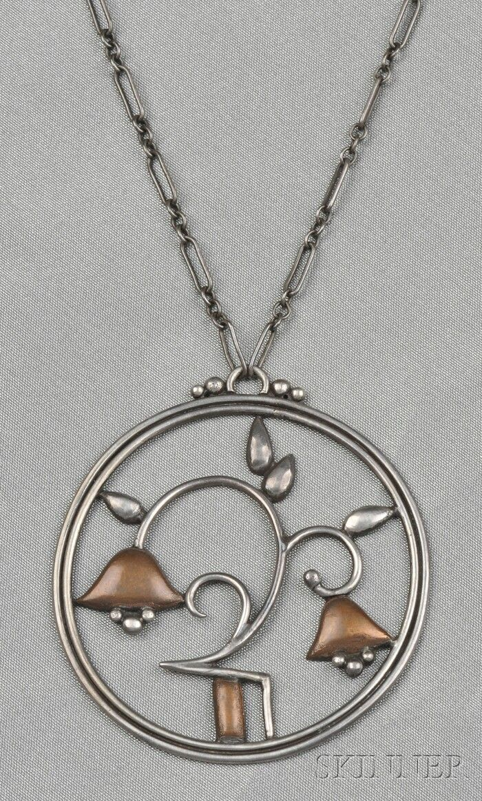 Wiener Werkstatte Silver and Copper Pendant, depicting geometric bellflowers, dia. 1 3/4 in., suspended from paperclip chain,