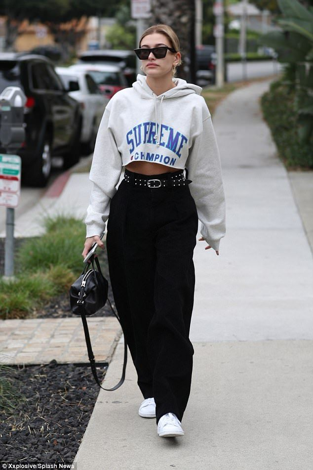 a28cdbb381c479 Hailey Baldwin flashes toned midriff in Supreme hoodie | 11/3/17 ...