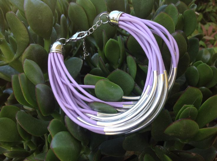 Indian Purple Leather with silver tube beads.