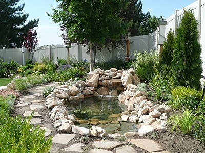 outdoor pond DIY.  Oooooh the hubby would LOVE something like this.
