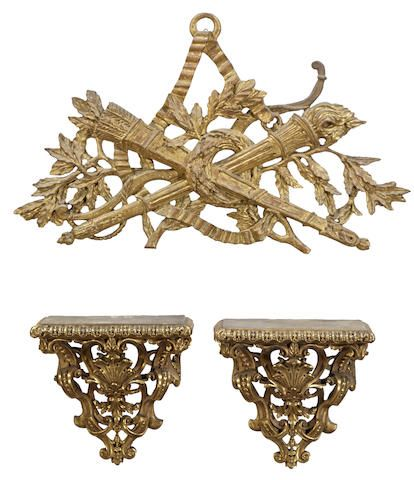 A pair of gilt plaster wall brackets and an Italian giltwood wall ornament  mid 20th century
