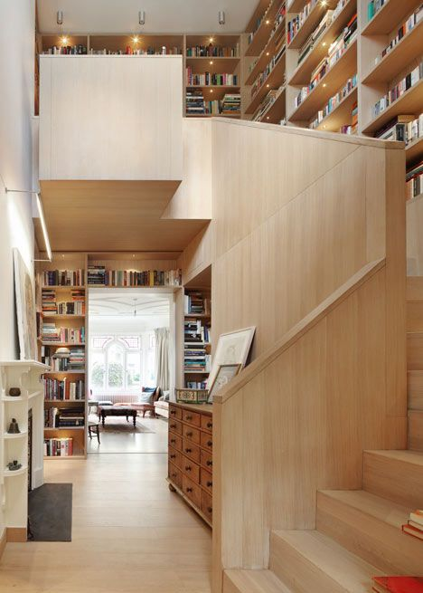 "It won't be long before our house looks like this!    When a client was looking to add an extension to their tall, narrow London home to house their library and a study space, Platform 5 architects came up with the idea to build the extension around a ""book tower""—a dramatic staircase incorporated staggered shelves culminating a top floor office space and library. This is a pretty great combination of height, secluded space, and open shelves 