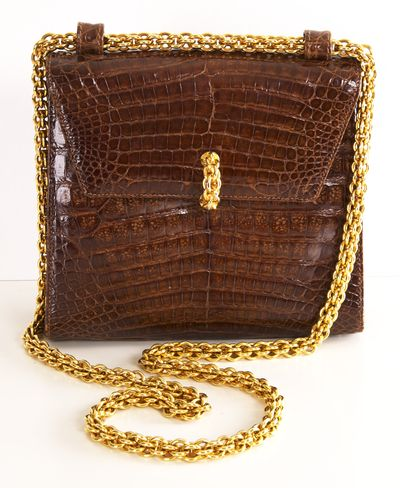 Paloma Picasso crocodile purse in brown with gilt metal chain-form clasp and strap, retaining the Paloma Picasso mini gold comb.