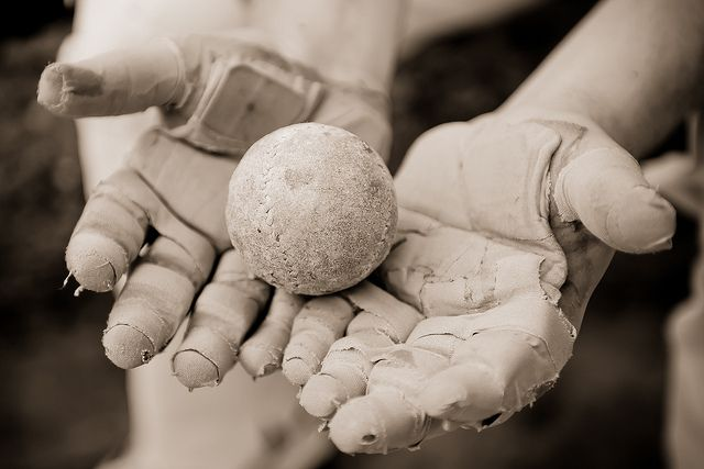 Detail of the padded hands and ball of a pelota (pelota a mano - handball) player after his match as part of the fiestas in Ondarroa | Flick...