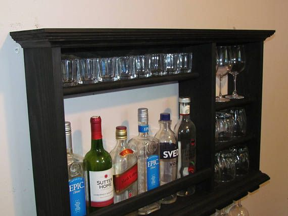 These Mini Bars are perfect for storing your barware in a small space, great for apartments, living rooms, or down in the man cave. Where else could you store 8 wine glasses, 6 highball glasses, and three more taller glasses, 8 to 9 shot glasses and 6 bottles of your favorite spirits all
