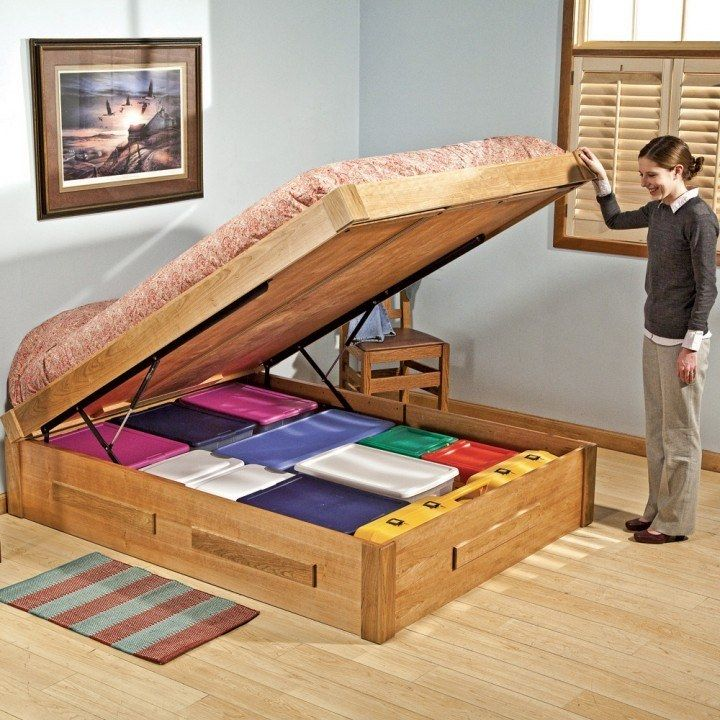 Bed Lift Mechanisms - this is a great storage idea. I could see storing bedding in there since comforters take up so much room.