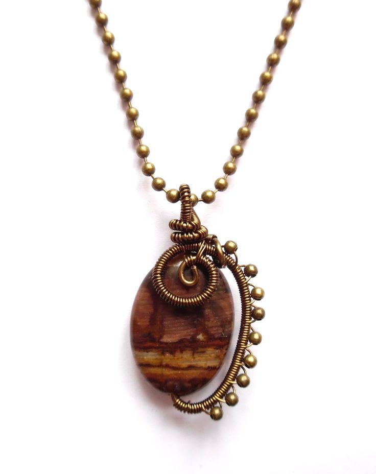 Steampunk halsband i brons med zebra agat.  Alla smycken är unika.  Hängets storlek: 4cm Kedjans längd: 50cm