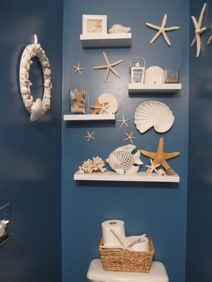 Bathroom. Good Nautical Themed Bathrooms Ideas. Great Superb Blue Nautical Beach Bathroom Interior Design With White Floating Shelves And Round White Sea Shell Framed Mirror Plus Star Fish Wall Decals. Nautical Themed Bathrooms
