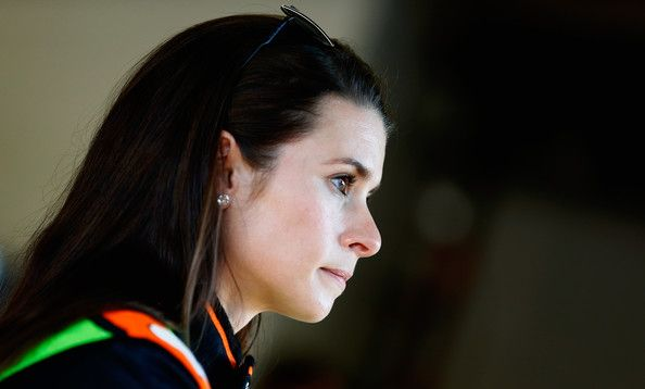 Danica Patrick Photos - Danica Patrick, driver of the #10 GoDaddy Chevrolet, looks on in the garage during practice for the NASCAR Sprint Cup Series Daytona 500 at Daytona International Speedway on February 19, 2014 in Daytona Beach, Florida. - Daytona International Speedway: Day 6