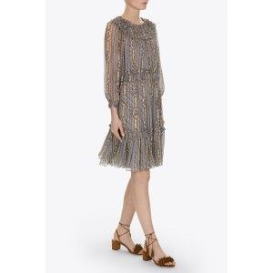 The Fleur Dress made from sheer crinkled chiffon creating an ethereal silhouette. Ruffle details give the dress a romantic edge and the elasticated neckline and cuffs allow for multiple styling options. The print, inspired by British antique wallpaper designs, consists of floral stripe motifs and is depicted in hues of dusty blues and taupe's. The self-fabric ties are finished with multi coloured silk tassels that complement the print.