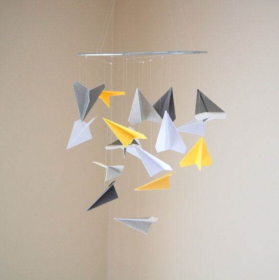 Hey, I found this really awesome Etsy listing at http://www.etsy.com/listing/98065541/cute-paper-airplane-mobile-choice-of