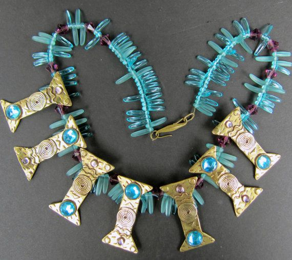A vintage piece of beautiful artwork by Deborah Roberts. This necklace is in the tribal look made with brass, frosted and clear blue dagger beads,