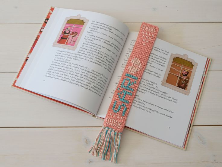 crocheted bookmark with cross stitch technique