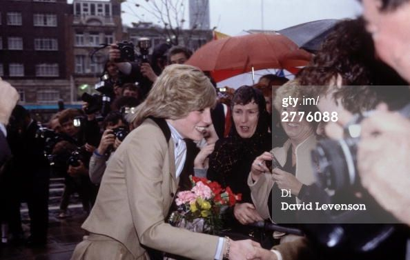 November 23, 1982: Princess Diana visits London's Capital Radio station to receive a book of fairy tales composed and illustrated by children for her son Prince William and to chat with the young authors.