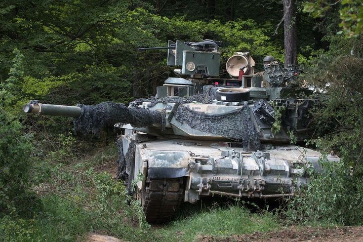 An army m1a1 abrams tank crew provides security during