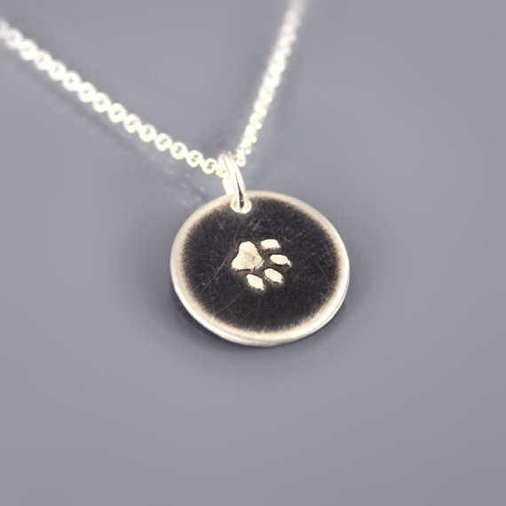 Tiny Silver Paw Print Necklace by Lisa Hopkins Design