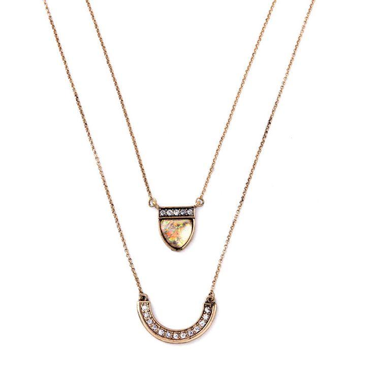 Collier fantaisie femme tendance . Collier double chaine.Collier composé de deux pendentifs strass sur deux chaînes en métal bronze de 50cm et 55cm.  Pendentifs 2.8cm et 1.5 cm