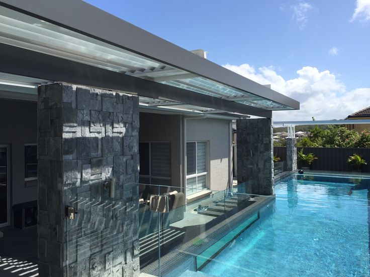 Fixed roof Patio and Eclipse opening roof create a poolside retreat.