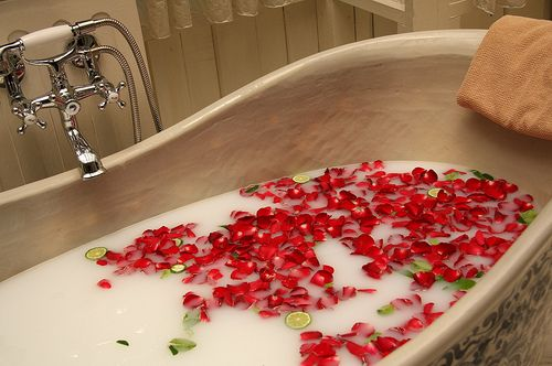 Milk bath with milk, honey, Epsom salt, lavender essential oil, rose petals, and lime slices. **Blissful sigh**