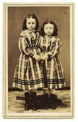 Post mortem photography, 1865-75, sisters posed standing,1 deceased (on right), Pella Iowa