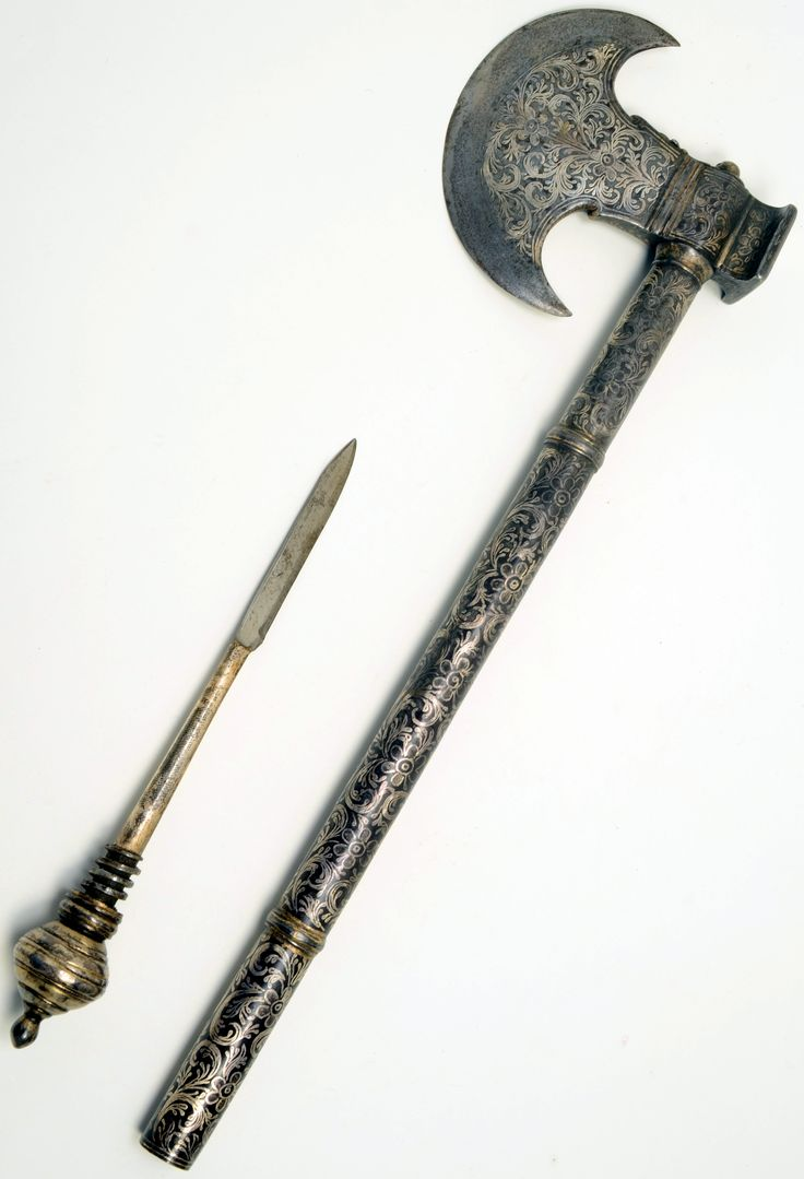 Indian (Sind) tabar (axe), 19th century, crescent shaped, steel blade decorated with inlaid silver, handle shaft decorated similar. Floral decoration, square rear hammer, circular pommel, screw in dagger from end of handle, 47cm, 13.5, Otago Museum.
