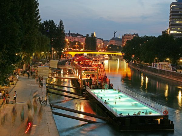 "Vienna's Danube ~ ""A repurposed cargo barge makes for a summertime floating pool, called the Badeschiff (Swim Ship), on Vienna's Danube Canal."" ~ Photograph by Georg Knoll/Bilderberg/Aurora Photos"
