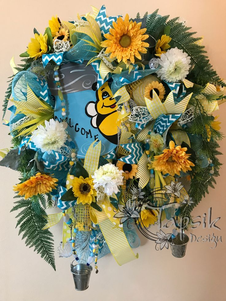 Summer Wreath, Sunflower Wreath, Welcome Wreath, Mason Jar Wreath, Front Door Wreath An awesome Summer Wreath suitable for front door. Base is blue deco mesh. Next are 5 kinds of ribbon strips and a bow. Next are sunflowers, greenery and other flowers, two tin buckets and a watering can, handmade bead garlands and handmade-decorated different sizes of twine balls. Which makes this wreath an unique one. And of course one cute mason jar sign with bumble bee and written welcome. This wreath is…