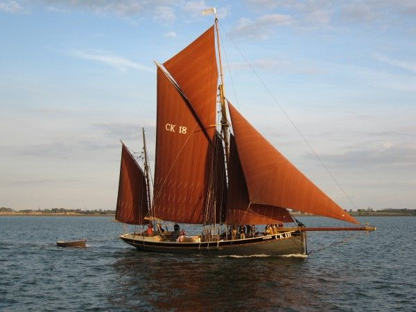 Smack PIONEER CK18 sailing into the evening sun on the River Blackwater. She was built 1886, derelict and sunk 1942, restored and relaunched 2003. For more information see ...