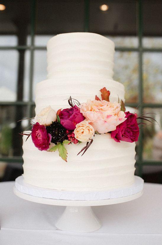 white wedding cake with flowers.