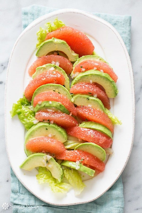 Grapefruit avocado salad! Healthy and delicious, grapefruit segments arranged with avocado slices, splashed with a citrus vinaigrette. #paleo #vegan #glutenfree Get the recipe on SimplyRecipes.com