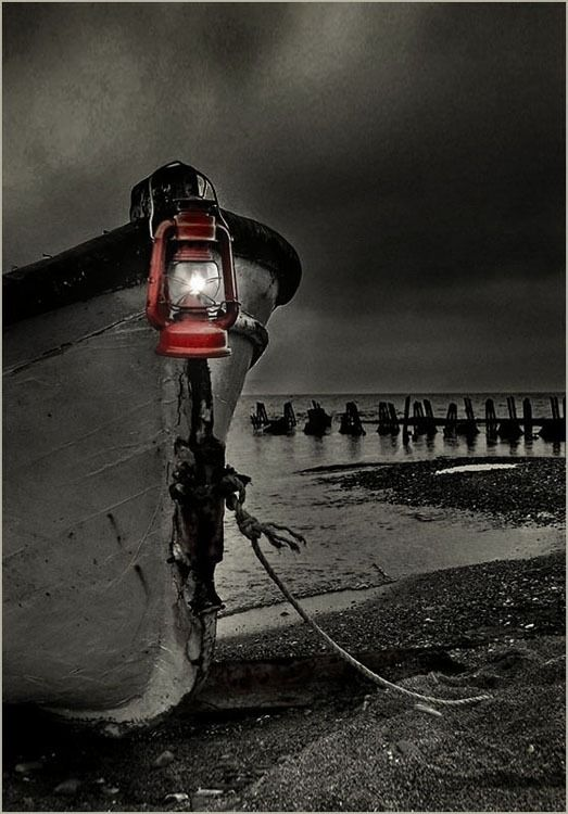 Black and white moored boat with red lantern