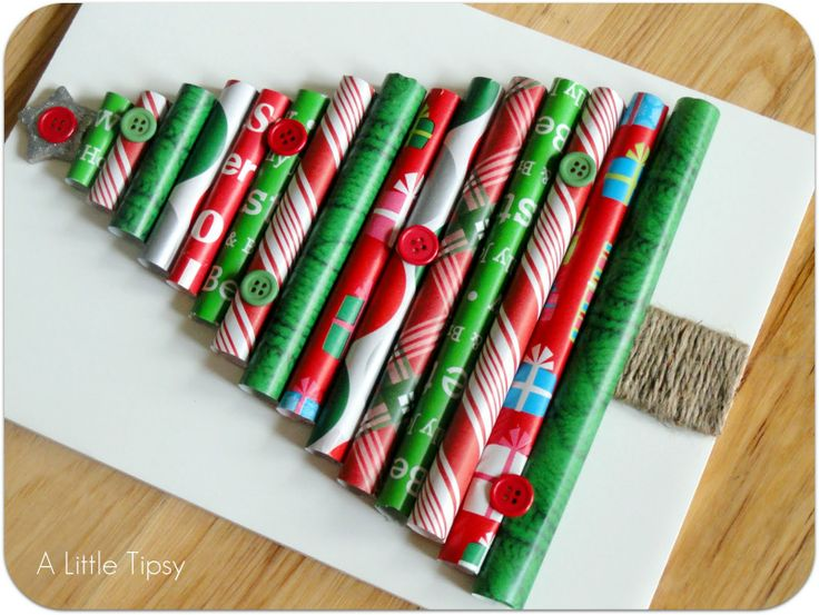 Cut pieces of wrapping paper rolled into tubes secured with a few glue dots. Secure the glue dots to the foam board making the tubes progressively smaller. Break a Popsicle stick in half. Put the halves side by side cover in glue & wrap with twine. Paint wood star with glitter glue for top