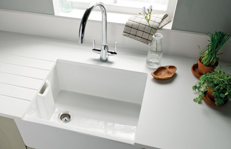 Minerva White worktop perhaps higher splasback? With drainage grooves. Use existing sink